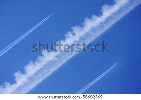 Two airliners with vapour trails