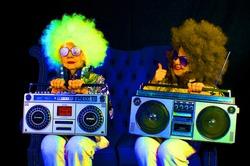 two amazing grandmas partying in a disco setting holding a retro ghettoblaster