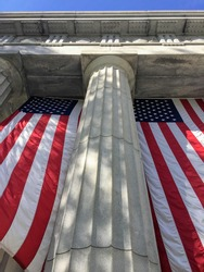 Two American flags hang in front of Grant's Tomb in New York City, USA