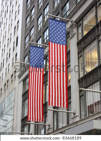 Two American Flags Hanging on side of Building in Manhattan New York