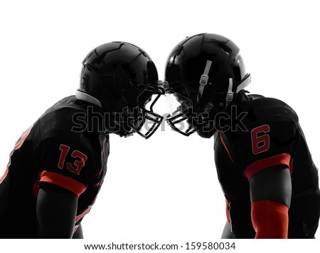 two american football players face to face in silhouette shadow on white background #159580034