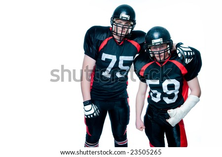 Two American football players, isolated on white