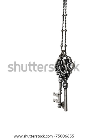 Two ancient keys on a chain isolated on a white background