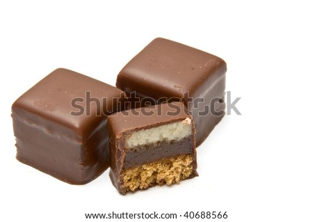 Two and a half filled chocolate cubes isolated on white