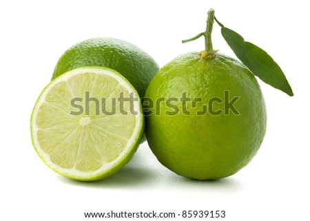 Two and half ripe limes. Isolated on white