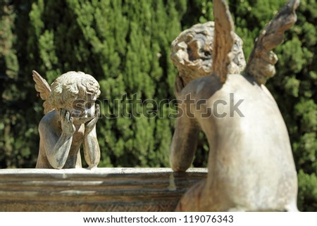 two angels - detail of the fountain in garden of Villa Peyron in Fiesole, Florence, Tuscany, Italy, Europe