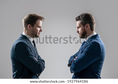 two angry businessmen standing face to face having struggle for leadership on businessmeeting because of business competition, business competition. Photo stock ©