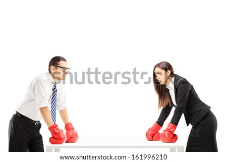 Two angry businesspeople with boxing gloves having an argument isolated on white background