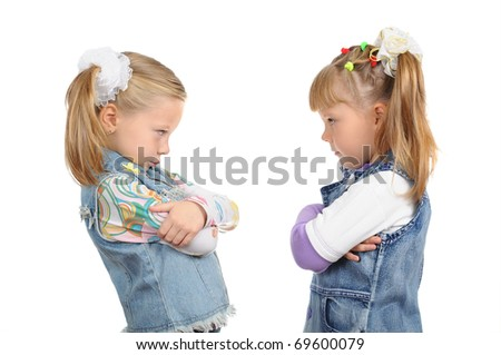 Two angry little girls on a white background