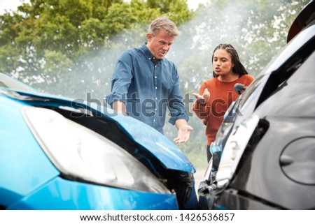 Two Angry Motorists Arguing Over Responsibility For Car Accident Сток-фото ©