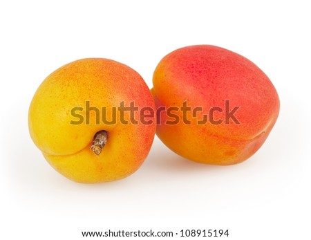 Two apricot isolated on white background with clipping path