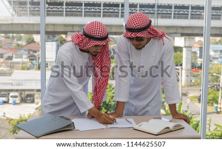 Two Arabian businessman talking agreement business contract #1144625507