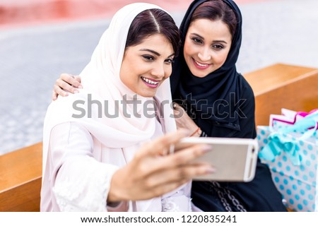 Two arabian girls spending time togehter outdoor making activities