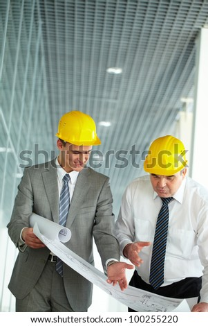 Two architects discussing new project at meeting