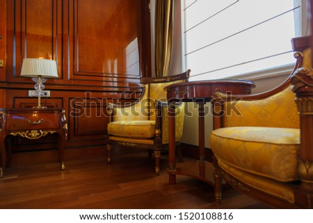 Two armchairs and a coffee table in a luxury apartment