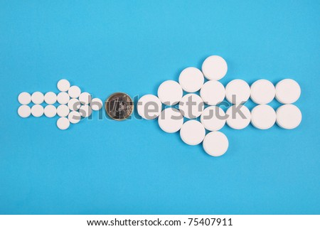 Two arrows collected of tablets are directed on a coin one euro. On a blue background.