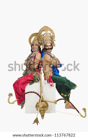 Two artists dressed-up as Rama and Ravana