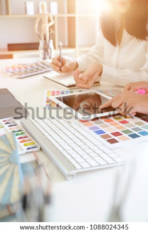 Two artists working on tablet, colour paper tone on workspace at the office #1088024345