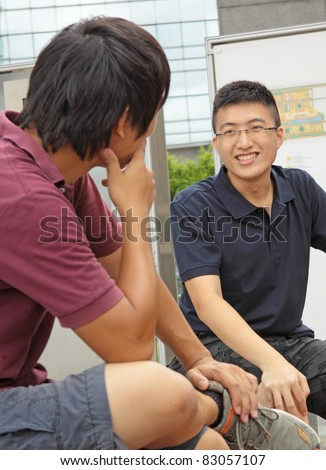 two asia man chatting outdoor