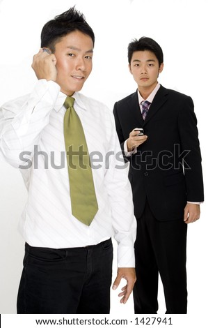 Two asian businessmen using mobile phones to communicate