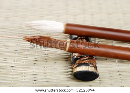 two asian calligraphy brushes
