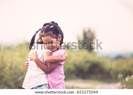 two asian little child girls...