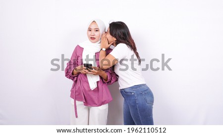 two asian women whisper whisper isolated white background Photo stock ©