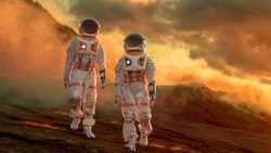 Two Astronauts Wearing Space Suits Walk Exploring Mars/ Red Planet. Space Travel, Exploration and Colonization Concept.