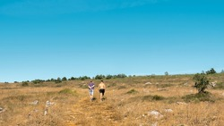 two athletic healthy young man hiking in a sunny summer day in the mountains of Palencia, Spain. Lifestyle concept
