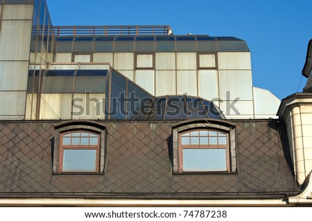 Two attic windows and blue sky