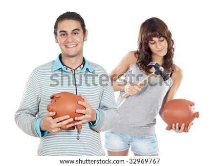 Two attractive girls with money box on a over white background