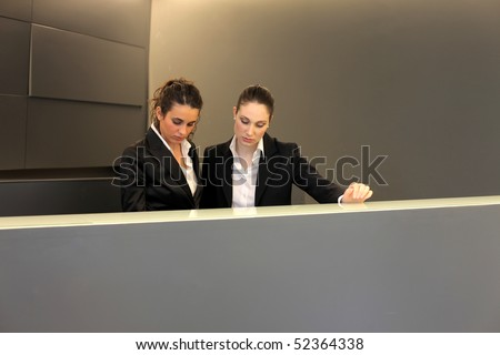 Two attractive receptionists