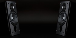 Two audio speakers with free space between them on a black background.