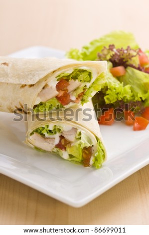 Two avocado wrap with a healthy side salad decorated