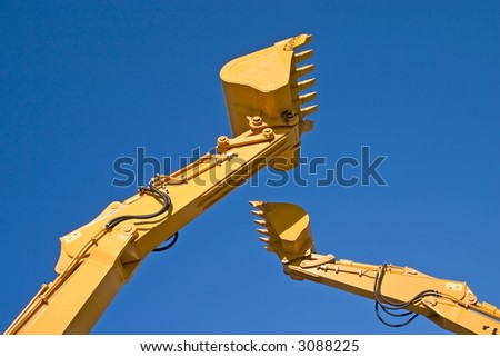 two back hoe diggers high in sky