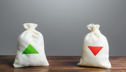 Two bags with green and red arrows up and down. Risk planning. Advantages and disadvantages. Useful and harmful. Decision making, evaluating profit consequences. Choice between positive and negative.