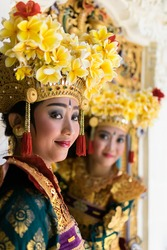 two Balinese Legong dancers at decorative window