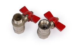Two ball valves with brass bodies and red butterfly handles stand with threaded connection of various design upwards on a white background