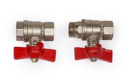 Two ball valves with brass bodies, red butterfly handles and various design of the threaded connection, side view on a white background