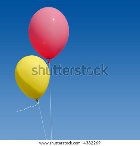 two balloons on blue sky background