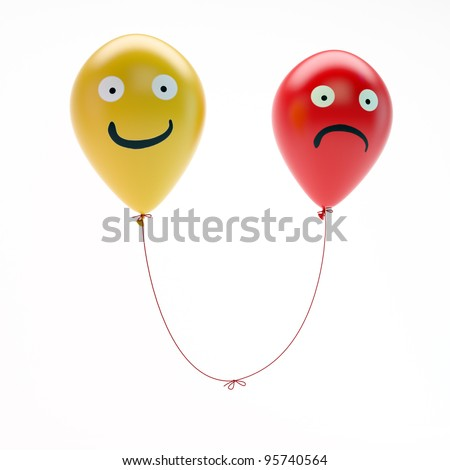 Two balloons with a happy and a sad face tied together