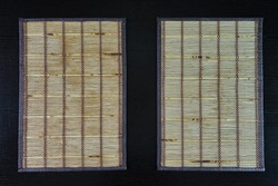 two bamboo mats on wooden table