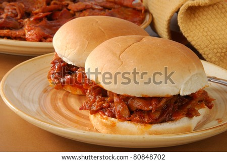 Two barbecue beef sandwiches on buns