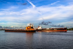 Two barges passing one another on Mississippi River