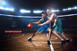 two basketball players during scrimmage on indoor basketball court