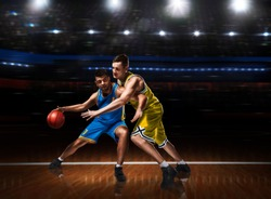 two basketball players in scrimmage during basketball match