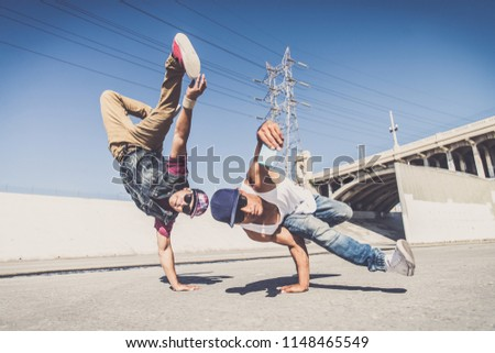 Two bbys doing some stunts - Street artist breakdancer taking an acrobatic selfie outdoors ストックフォト ©