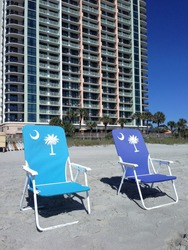 Two beach chairs at the seashore