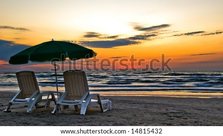 two beach chairs before sunrise