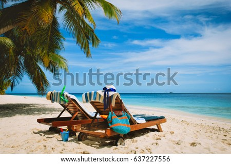 Two beach chairs on tropical vacation #637227556